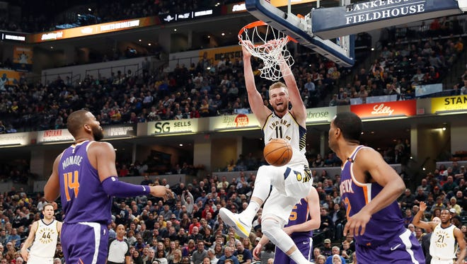 Jan 24, 2018: Indiana Pacers forward Domantas Sabonis (11) dunks against Phoenix Suns center Greg Monroe (14) and forward T.J. Warren (12) during the first quarter at Bankers Life Fieldhouse.