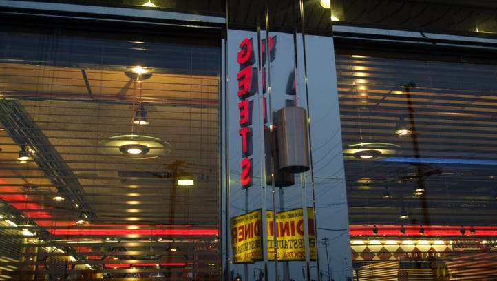 The Geets Diner sign is reflected in the side of the