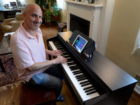Ed Baig plays the One Smart Piano. --    Photo by Robert