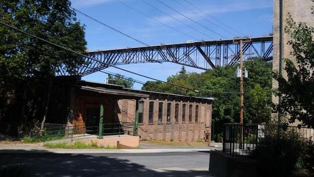 The railroad bridge is seen in the background from The Children's Museum on North Water Street in Poughkeepsie.