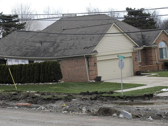 A sinkhole buckles this Fraser home in 2016.