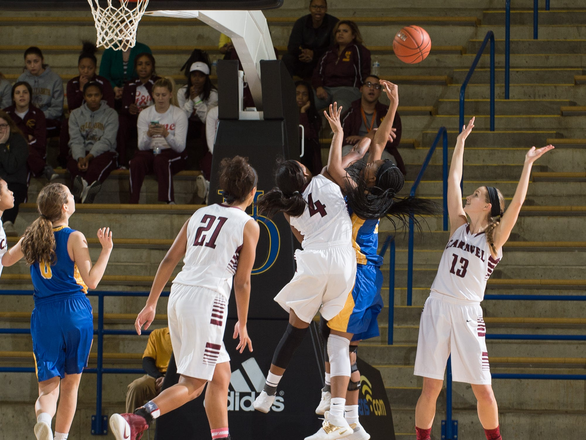 Caravel's Sasha Marvel (4) knocks the ball from A.I. duPont's Al'kirah Wilson (15) in their game at the quarterfinals of DIAA Girls Basketball Tournament at the University of Delaware.