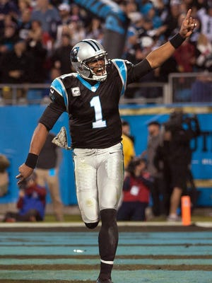 Cam Newton celebrates his game-winning TD pass late in the fourth quarter.