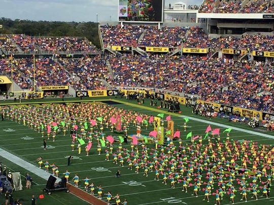 Lindsey Thomas and other All American cheerleaders performed in front of more than 65,000 spectators at the televised game between the Michigan Wolverines and Florida Gators