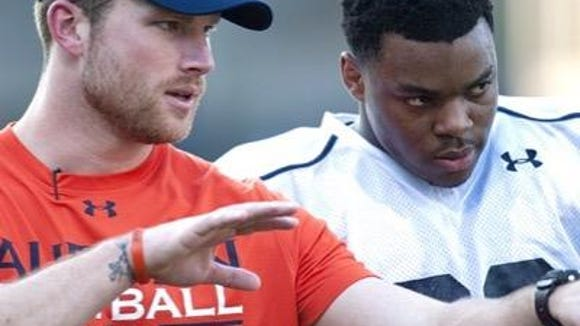 Auburn graduate assistant Blake Gideon coaching Tigers defensive back Jonathan Ford in practice. Gideon has agreed to a graduate assistant position at South Carolina.