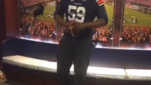 Auburn 2016 signee Brodarious Hamm trying on his Auburn jersey during his recruiting trip in January 2016.