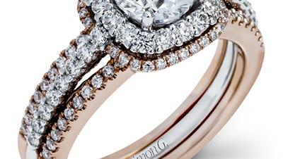 A Simon G layered engagement ring and wedding band set.