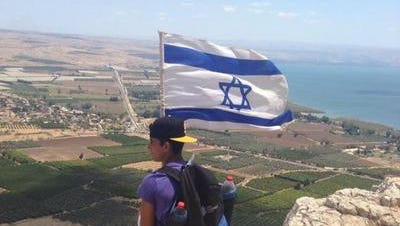 Jeremy Berger, 16, of New Rochelle sits atop Mount Arbel in Israel this week during his summer program in Israel.