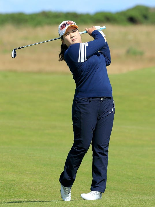 Inbee Park follows through on a swing during her final practice round ...