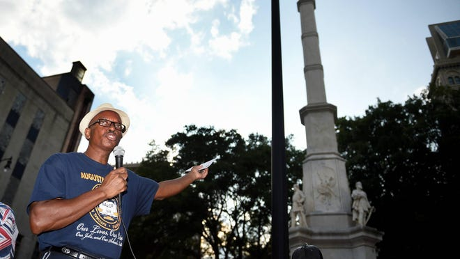 Melvin Ivey of the Augusta chapter of the NAACP speaks to a crowd gathered near the Confederate monument during a rally in Augusta on August 24, 2018.