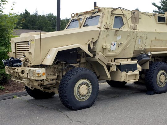 A mine-resistant vehicle sits in front of police headquarters in Watertown, Conn.