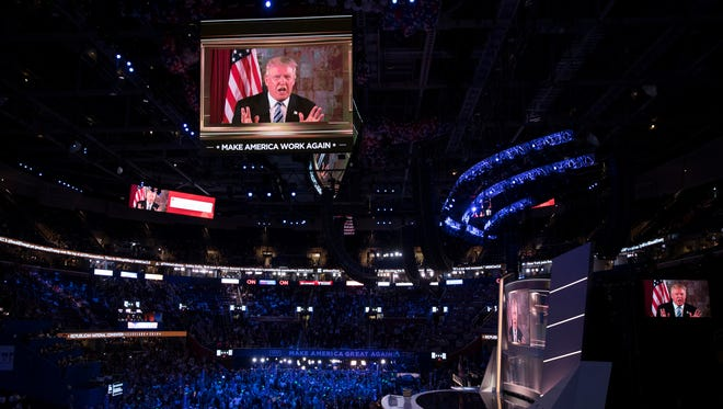 Republican presidential candidate Donald Trump appears on a video monitor during the Republican National Convention on Tuesday in Cleveland.