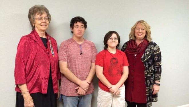 Pictured are, from left to right, Jolene Goodwin, Shelby Taylor, Ryan Helmer and JMA principal Stacey Frakes.