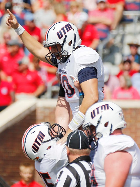 Tennessee Martin quarterback Troy Cook (10) celebrates his two-yard touchdown run with teammates in the first half of an NCAA college football game against Mississippi in Oxford, Miss., Saturday, Sept. 9, 2017.(AP Photo/Rogelio V. Solis)