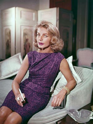 FILE - This 1965 file photo shows actress Lauren Bacall at her home in New York. Bacall, the sultry-voiced actress and Humphrey Bogart's partner off and on the screen, died Tuesday, Aug. 12, 2014 in New York. She was 89. A model at 16, later a pal of Yves Saint Laurent and a frequent wearer of designs by Norman Norell. (AP Photo, File)