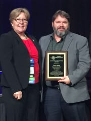 Dave Sharp, science operations officer with NWS in Melbourne, received the Public Education Award on Thursday at the 30th annual Governor's Hurricane Conference in Orlando.