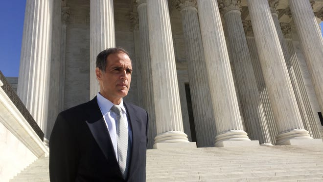 Florida resident Fane Lozman stands on the steps of the Supreme Court in February after the justices debated his free speech case.