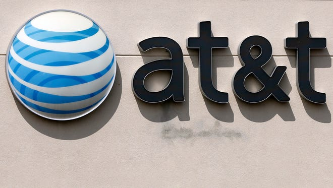 This May 14, 2014 file photo shows an AT&T logo on a store in Dedham, Mass. On Saturday, Oct. 22, 2016, several reports citing unnamed sources said the giant phone company is in advanced talks to buy Time Warner, owner of the Warner Bros. movie studio as well as HBO and CNN. AT&T is said to be offering $80 billion or more, a massive deal that would shake up the media landscape.