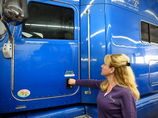 Brenny Transportation CEO Joyce Brenny looks at a sticker on the window of a semi-tractor as part of the company's efforts in the Truckers Against Trafficking program during an interview Friday, Feb. 10, at the company's St. Cloud headquarters.