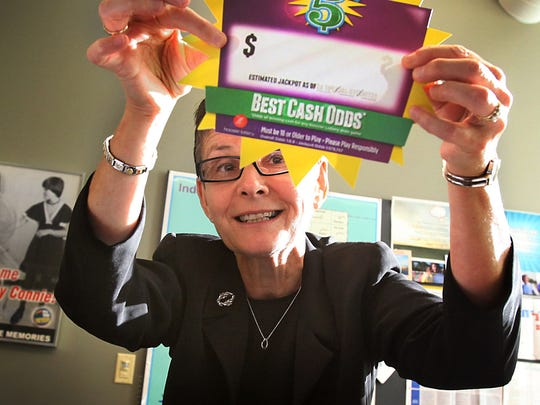 Connie Laverty O'Connor  (displaying a printed advertisement for the  Cash 5 game)  was interim CEO of GTECH Indiana in 2012, when the company rceived a contract to manage the Hoosier Lottery on a day-to-day basis.