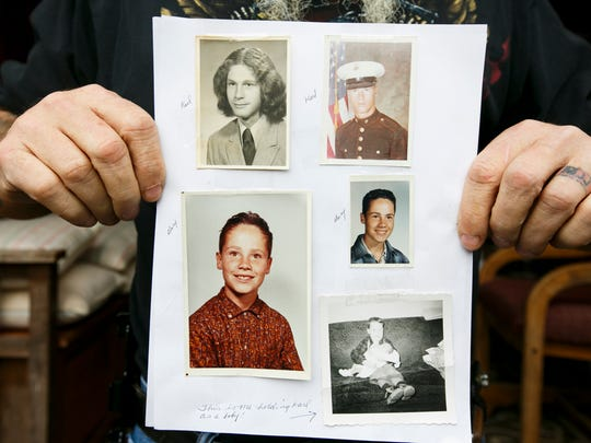 Karl Jensen holds up pictures of him and his older brother, Gary Jensen. The one on the lower right shows infant Karl being held by 6-year-old Gary.