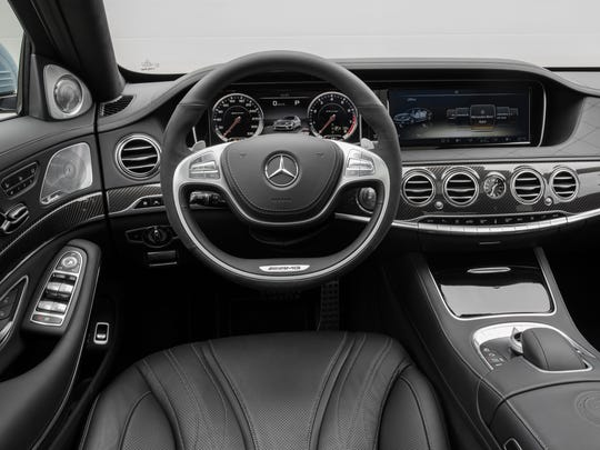 The interior of the sumptuous 2014 Mercedes-Benz S63 AMG 4MATIC oozes elegance with twin LCD screens, expanses of stitched leather and real wood.