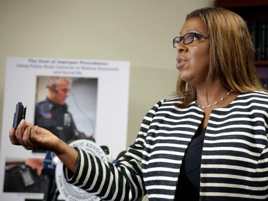 """New York City Public Advocate Letitia James holds a news conference Thursday at her office in New York, to unveil a proposal that would require police to wear body cameras. The initiative would cost the city $5 million, but would be a """"win-win,"""" James said, saving tax-payer dollars while holding police officers accountable during civilian stops and exonerating officers falsely accused of misbehavior."""