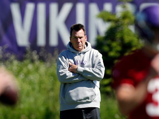 FILE - In this June 13, 2019, file photo, Minnesota Vikings assistant head coach and offensive advisor Gary Kubiak watches quarterbacks during drills at the team's NFL football training facility in Eagan, Minn. The Vikings have chosen Kubiak as their offensive coordinator. He fills the vacancy created by Kevin Stefanski's departure to become head coach of the Cleveland Browns. The widely expected move was confirmed by a person with knowledge of the decision. The person spoke to The Associated Press on condition of anonymity because the club had not yet made the announcement. The 58-year-old Kubiak served as offensive adviser and assistant to head coach Mike Zimmer this season. (AP Photo/Andy Clayton- King, File)