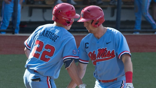 Ole Miss' J.B. Woodman celebrates a solo home run with Henri Lartigue in the fourth inning against Kentucky.