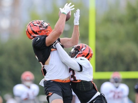 Cincinnati Bengals tight end Tyler Eifert (85) makes a catch over Cincinnati Bengals defensive back George Iloka (43) during Cincinnati Bengals training camp practice, Saturday, Aug. 11, 2018, at the practice fields next to Paul Brown Stadium in Cincinnati.