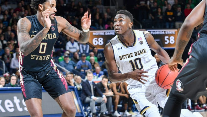 Feb 10, 2018; South Bend, IN, USA; Notre Dame Fighting Irish guard T.J. Gibbs (10) drives to the basket as Florida State Seminoles forward Phil Cofer (0) defends in the second half at the Purcell Pavilion.