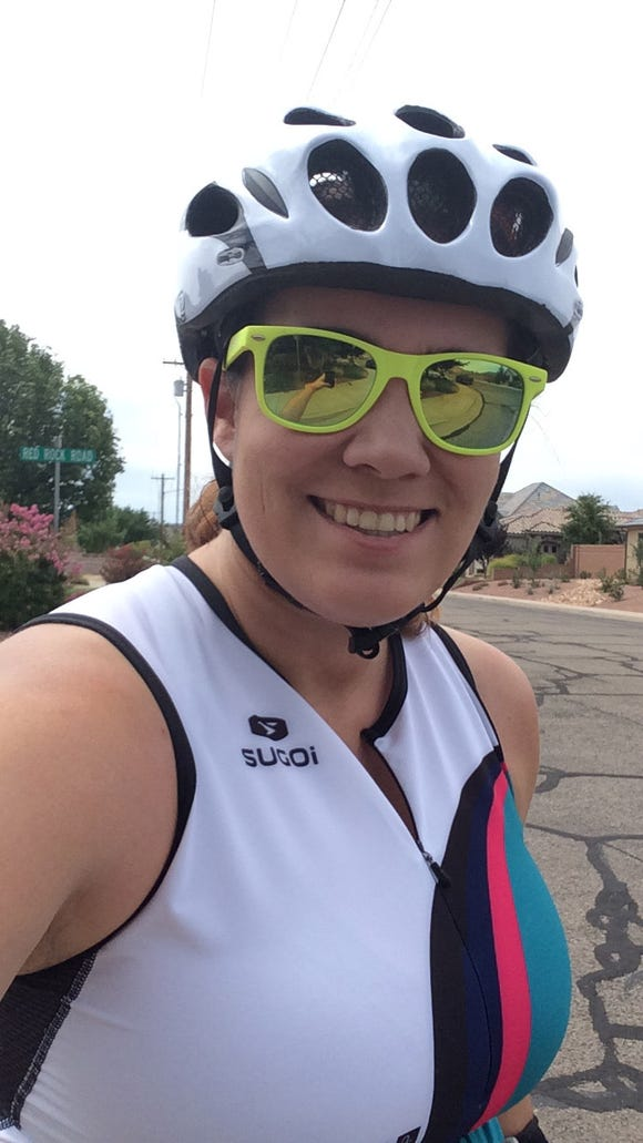 Casie Forbes gets ready to start a bike ride in Santa Clara in preparation for the 2016 St. George Ironman North American Pro Championships.