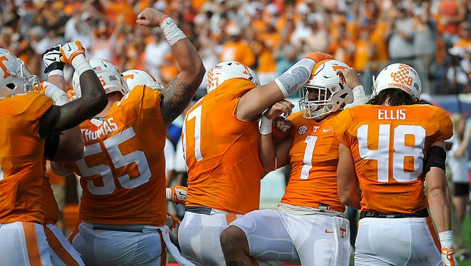 Tennessee teammates congratulate running back Jalen Hurd (1) after his touchdown during the first half against Bowling Green at Nissan Stadium on Sept. 5, 2015.