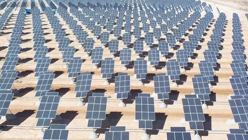 "Solar panels gather energy at Nellis Air Force Base in Las Vegas. The  Nevada Public Utilities Commission has essentially raised rates for all ""net mettering"" customers."
