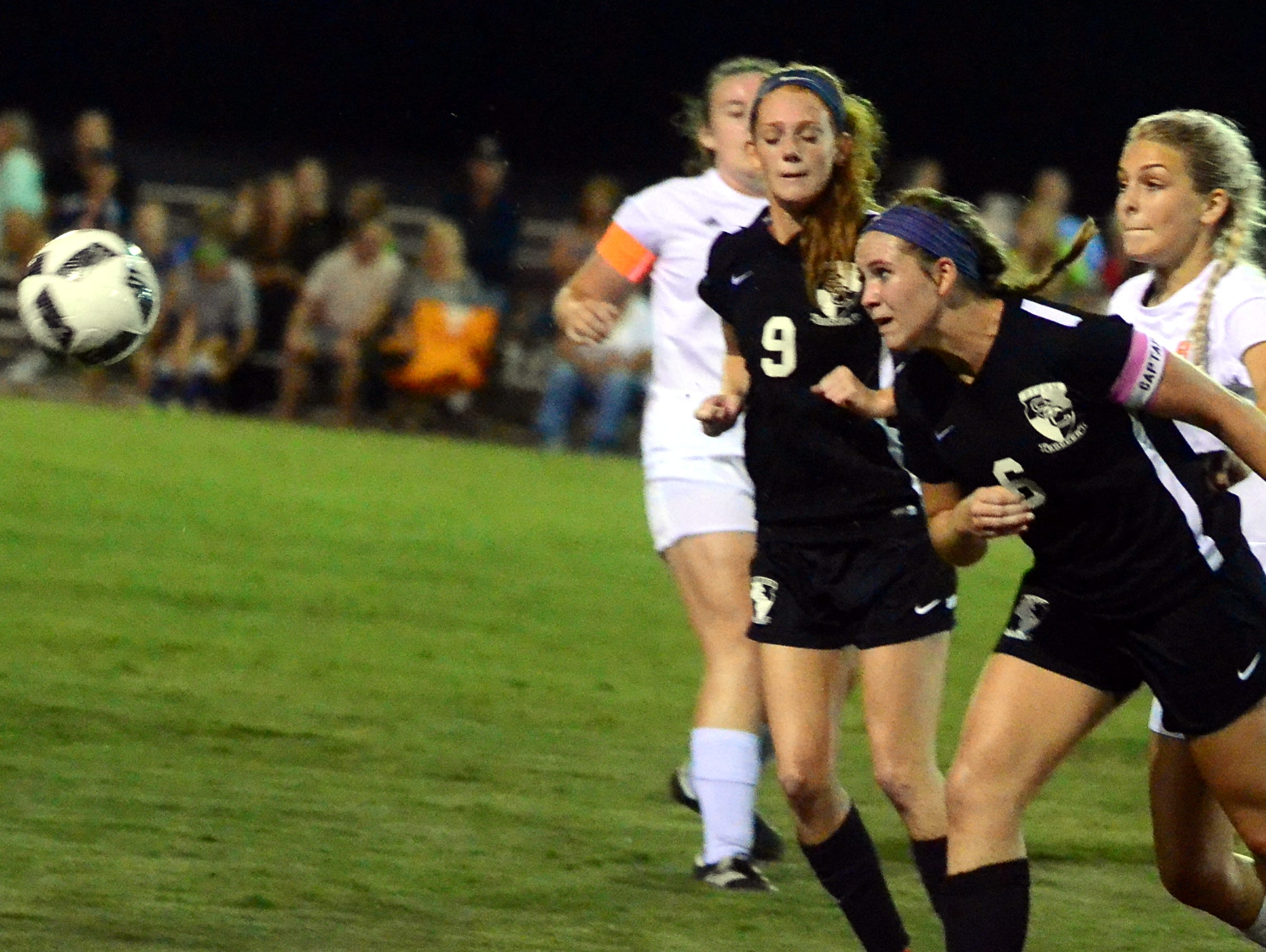 Station Camp High senior Victoria Brown heads the ball away from Beech players during second-half action.