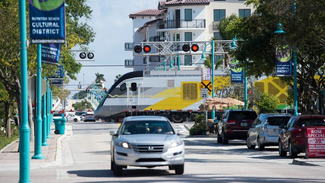 A Brightline train traveling north crosses East Ocean Avenue and Northeast 4th Street on Thursday, Jan. 18, 2018 in Boynton Beach. On Jan. 17, Jeffrey D. King, 51, of Boynton Beach, was killed by a train when he pedaled around the gates, the second fatality by a Brightline train in a week.