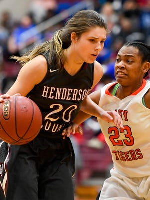 Henderson's Emma Lander drives past Hopkinsville's Amari Brodie as Henderson County plays Hopkinsville in the second Second Region semifinal game in Mortons Gap Friday, March 3, 2017.
