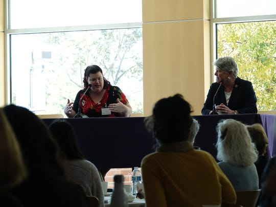 Jessica Lavariega Monforti, left, dean of the College of Arts and Sciences at California Lutheran University, speaks during an immigration forum Saturday as Rep. Julia Brownley listens.