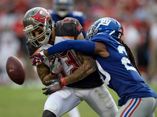 Tampa Bay Buccaneers wide receiver Mike Evans (13) has a pass knocked away by New York Giants cornerback Janoris Jenkins (20) during the fourth quarter of an NFL football game Sunday, Oct. 1, 2017, in Tampa, Fla. (AP Photo/Jason Behnken)