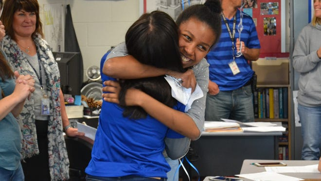 Temnit Ketemo, right, hugs Priscila Melendez Carnero after the juniors were named Coloradoan 2018 First Class Scholars on Friday, May 18, 2018, at Poudre High School in Fort Collins, Colo.