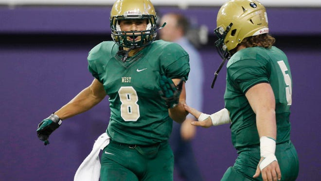 Iowa City West's Oliver Martin (8) celebrates his touchdown with teammate Breyton McDole Friday, Nov. 11, 2016, during their 4A state semifinal game at the UNI Dome in Cedar Falls.