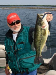This early season bass, held by Charlie Simkins, fell to a wacky worm lure.