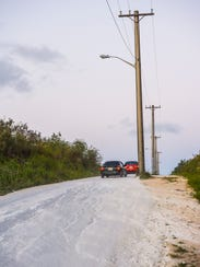 Signs of deterioration and erosion can be seen on Lucas Sablan Boulevard in Yigo as motorists drive on the roadway on Thursday, March 8, 2018.