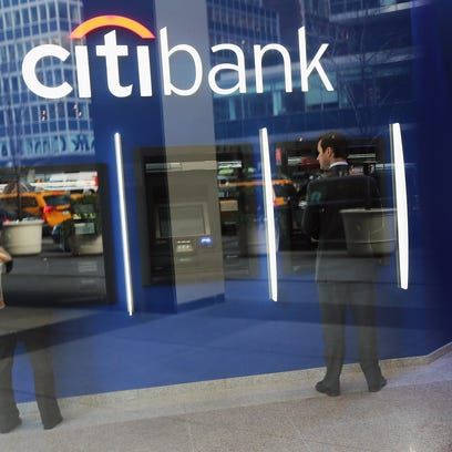 People use ATM's at Citibank headquarters in Manhattan