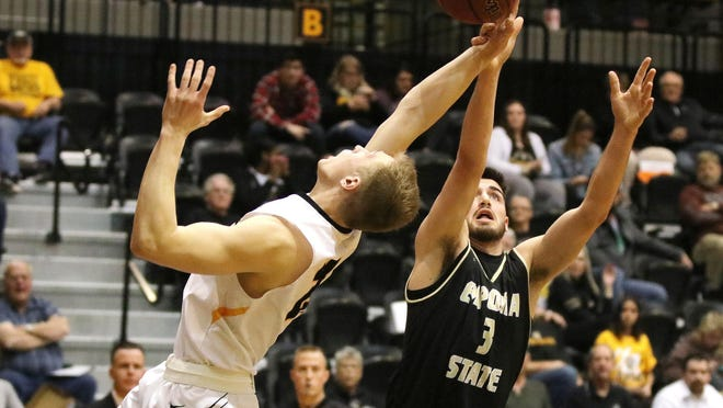 Fort Hays State University's Jared Vitztum stretches for a rebound against Emporia on during a game last season at Gross Memorial Coliseum in Hays.
