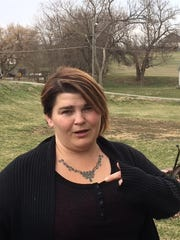 Tina Polly describes a struggle Logan and her husband had on their front lawn in Council Bluffs.