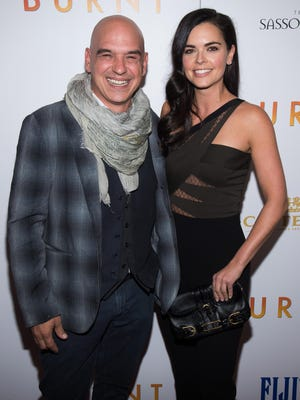 """Michael Symon and Katie Lee attend the premiere of """"Burnt"""" at the Museum of Modern Art on Tuesday, Oct. 20, 2015, in New York."""