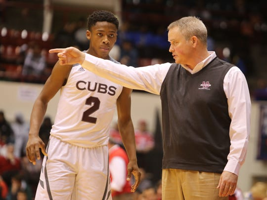 Pat Donnelly talks to guard Elijah Collins during the Catholic League Championship game against St. Mary's Prep at Calihan Hall in Detroit on March 1, 2015.