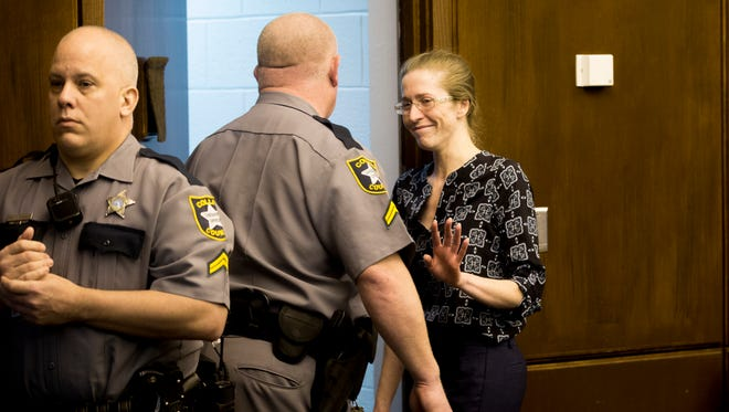 Lisa Troemner smiles and waves to her family while exiting the courtroom after the jury reached a not guilty verdict at the Collier County Courthouse early Friday, Feb. 9, 2018, in Naples. Troemner, 27, faced a charge of second-degree murder in the death of Trevor Smith, 30, in the Marco Island condo they shared during an argument Dec. 2, 2014. After the ruling it is assumed the jury believed she acted in self-defense.