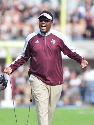 Texas A&M Aggies head coach Kevin Sumlin reacts after a penalty during the first quarter of the game against the Mississippi State Bulldogs at Davis Wade Stadium.